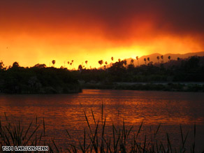Smoke from a wind-fueled wildfire casts a glow over Santa Barbara.