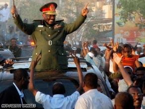 Sudan's President Omar Hassan al-Bashir waves to supporters in Khartoum on Wednesday.
