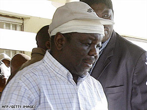 Morgan Tsvangirai leaves the hospital Saturday after being treated for injuries from a car crash.