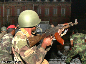 Madagascan soldiers loyal to opposition leader Andry Rajoelina outside the presidential palace Monday.