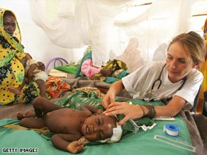 A Doctors without Borders medic helps a sick child in a Darfur refugee camp.