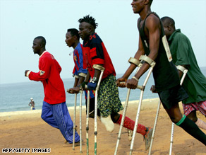 Amputee victims of Sierra Leone's civil war take part in football training at a beach in Freetown.