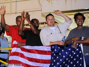 Crew members of the Maersk Alabama celebrate after hearing the Navy had rescued their captain from pirates.