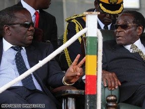 Prime Minister Morgan Tsvangirai, left, and President Robert Mugabe have a power-sharing agreement.