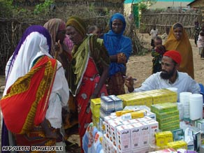 Somali women wait to get medicine at a clinic near Mogadishu in July.