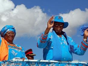 Malawian President Bingu wa Mutharika, right, and running mate Joyce Banda wave in Blantyre on May 14.