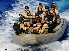 U.S. Navy rescues Somali men women and children stranded aboard a small skiff off Somalia's coast.