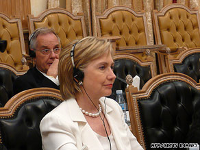 Hillary Clinton listens to Angolan Foreign Minister Assuncao dos Anjos, not pictured, on Sunday.
