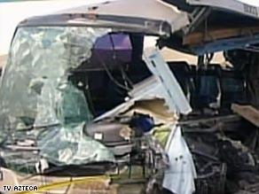 Video from the crash scene in northeast Mexico shows the side of the bus sheared away.