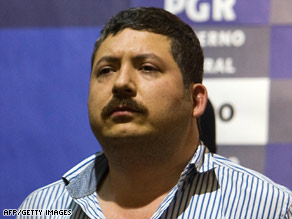 Suspected drug kingpin Hector Huerta Rios faces members of the press Wednesday in Mexico City.