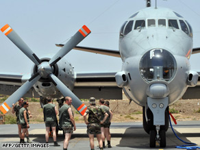 Crew members of a French maritime patrol aircraft prepare Tuesday to search for the missing jet.
