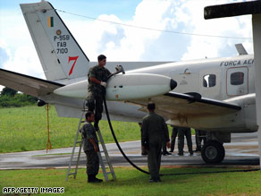 A Brazilian radar plane is fuelled up Monday at the Fernando de Noronha airport to search for Flight 447.