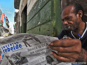 A Cuban reads a newspaper Thursday announcing the OAS had lifted its suspension of Cuba's membership.