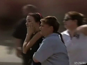 People arrive Friday at the scene of a fire at a daycare in Hermosillo, Mexico, where 27 children died.