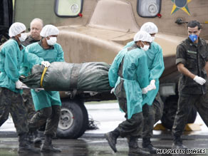 Brazilian military personnel on Tuesday carry the remains of one of the passengers of the Air France crash.