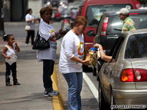 Globovision supporters ask for money last week in Caracas to help pay a fine against the TV network.