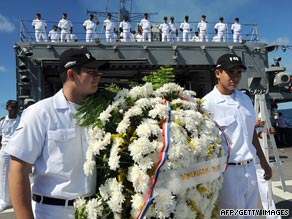 Brazilian Navy officers hold a wreath during a tribute held on Monday to victims of Air France Flight 447.