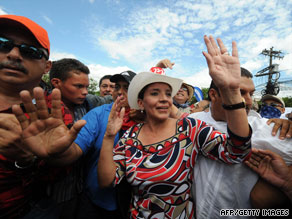 Honduran first lady Xiomara Castro de Zelaya joins a protest march Tuesday in Tegucigalpa.