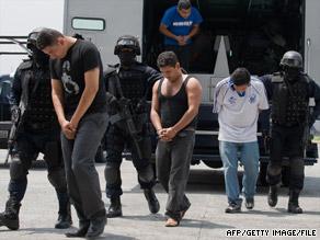 Members of the drug cartel 'La Familia Michoacana' are presented to the press in Mexico City in June.