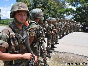 Honduran soldiers block the road at the Honduras-Nicaragua border in Paraiso, Honduras.