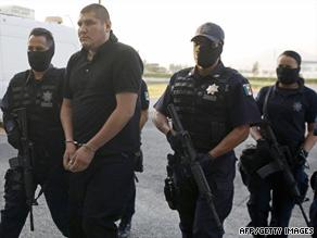 Police escort suspected drug cartel leader Jose Alberto Lopez Barron on Wednesday in Mexico City.