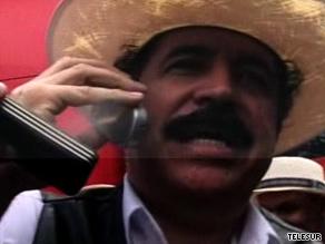 Ousted Honduran President Jose Manuel Zelaya waits at the border Friday afternoon.