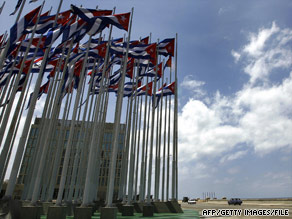 Cuban flags flutter in front of the U.S. interests section building in Havana in 2007.