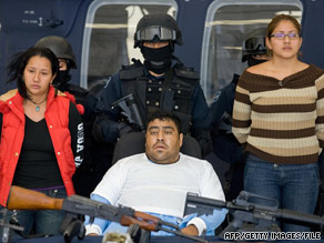 Suspected members of Los Zetas drug cartel are presented to reporters in Mexico City in April.