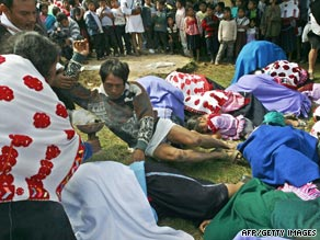Mexican Mayan Indian massacre survivors reenact the killings of 45 people in Acteal village in this 2003 photo.