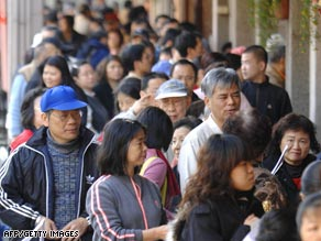 (Photo, courtesy of CNN)  People line-up to wait their turn to receive their vouchers from the city government.  (Photo dated to January 19)