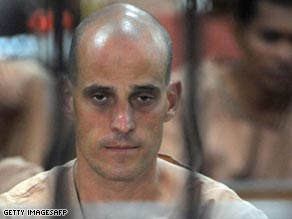 Harry Nicolaides behind the bars of a Thai holding cell on Monday.