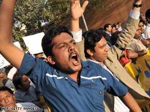 Pakistani journalists shout slogans during a protest in Karachi against the killing of a journalist in Swat Valley.