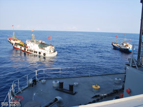 The Navy says this photo shows two Chinese trawlers forcing the Impeccable to make an emergency stop.
