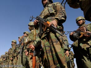 Afghan National Army (ANA) soldiers listen to a speach in Nadi Ali district, Helmand province, on February 5, 2009.