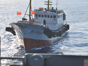 The Navy says this shows a trawler crew member using a hook to try to snag the Impeccable's towed acoustic array.