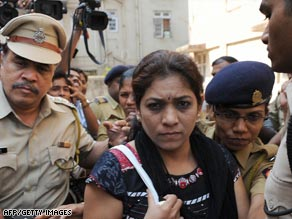 Indian police escort lawyer Anjali Waghmare as she leaves her residence in Mumbai on March 31.