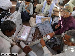Indian election officials check electronic voting machines prior to Wednesday's vote.