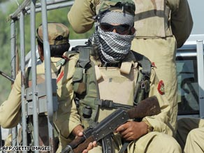 Pakistani security personnel patrol the troubled Buner district.