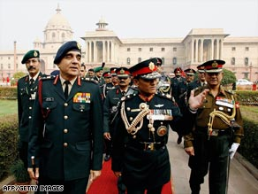General Rookmangud Katawal gestures after inspecting the guard of honour in New Delhi on December 12, 2007.