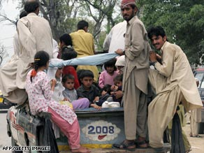 Displaced people from Buner district flee the fighting.