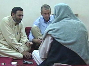 CNN's Nic Robertson, center, talks to Taliban spokesman Zabiullah Mujahid, right, at an undisclosed location.