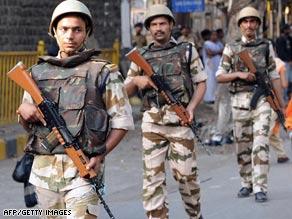 Soldiers patrol in Mumbai as the trial gets under way.
