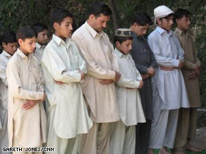 A moment of prayer and reflection for the orphans and one of their teachers.