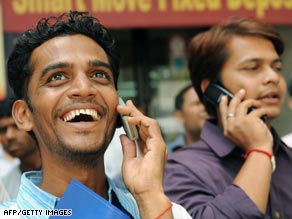 Onlookers outside the stock exchange in Mumbai Monday watch share prices surge following the election results.