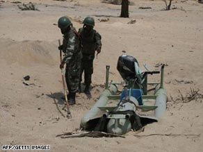 Sri Lanka's defense ministry says this handout photo shows troops with a captured Tamil Tiger craft.