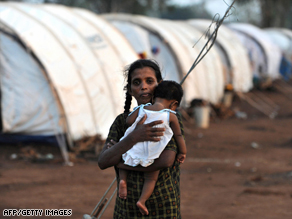 A Tamil refugee holds her child at a tented site in Vavuniya.