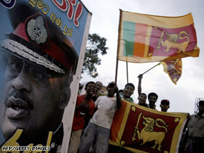 A crowd beside a portrait of Sri Lanka's president celebrate the country's military victory on May 18.
