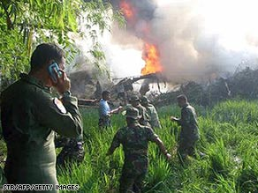 Soldiers search for victims at the plane's crash site in East Java Wednesday.