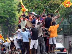 Sri Lankan youth celebrate on the street in Colombo on May 20, 2009.