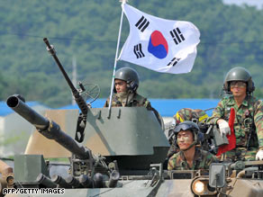 South Korean soldiers ride in armored vehicles during a drill Friday in the border city of Paju.